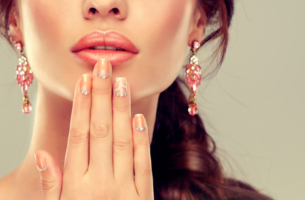Luxury fashion style, manicure nail , cosmetics and make-up . beige nails with rhinestones .Beauty , skincare , makeup and cosmetics